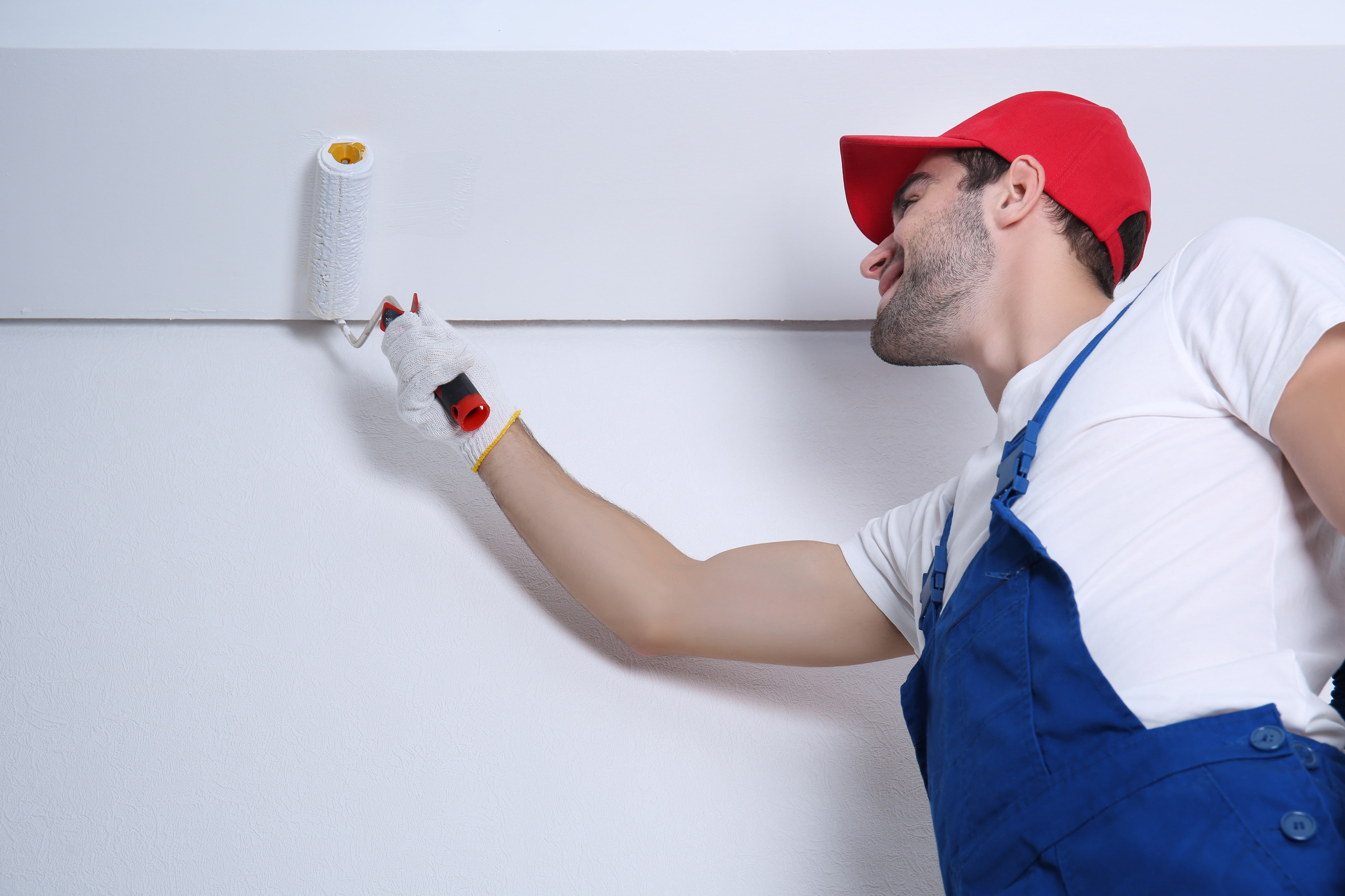 Guy painting the wall